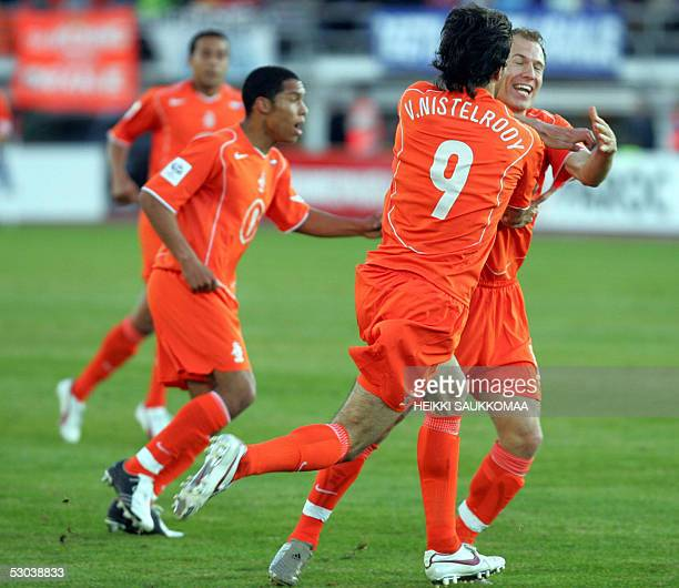 Dutch Ruud van Nistelrooy celebrates his first goal with teammates Arjen Robben and at left Nigel de Jong during their World Cup 2006 qualifying...
