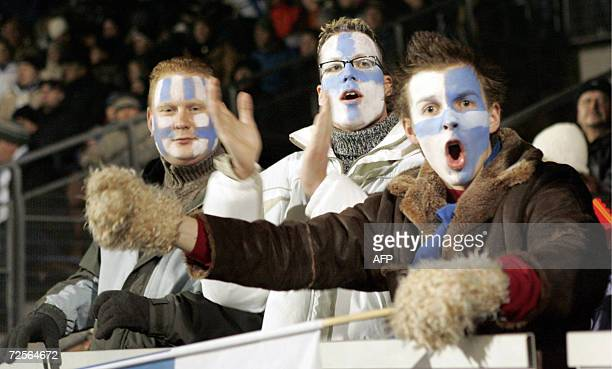 Finnish fans cheer during Group A Euro 2008 qualifying football match between Finland and Armenia 15 November 2006 in Helsinki Finland won the match...