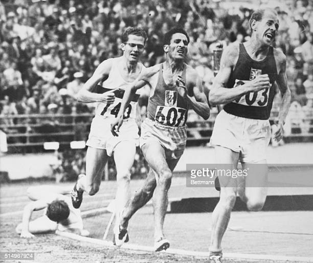 Olympic 5000M run with Emil Zatopek winner followed by A Mimoun France H Schade Germany and C Chataway of Great Britain falls by the side of the track