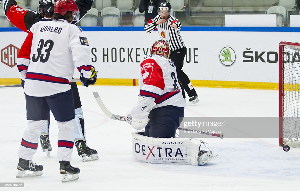 Helsinki players looks on dejected as they concede a goal Scored by Anders Overmark during the Champions Hockey League group stage game between Sonderjyske Vojens and IFK Helsinki on August 21, 2014 in Vojens, Denmark.