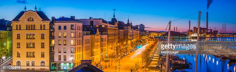 Helsinki waterfront panorama apartment buildings harbour illuminated at dusk Finland