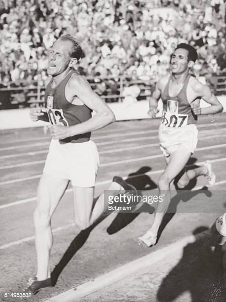 Zatopek Wins 10000 Meter Run Emil Zatopek of Czechoslovakia paces Alain Mimoun of France in the finish of the 10000 meter run in Olympic Stadium July...