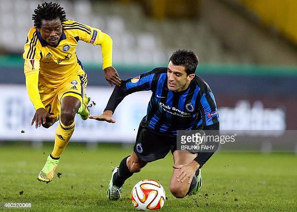 Helsinki's Anthony Annan and Brugge's Fernando Menegazzo vie for the ball during UEFA Europa League group B football match between Club Brugge and...