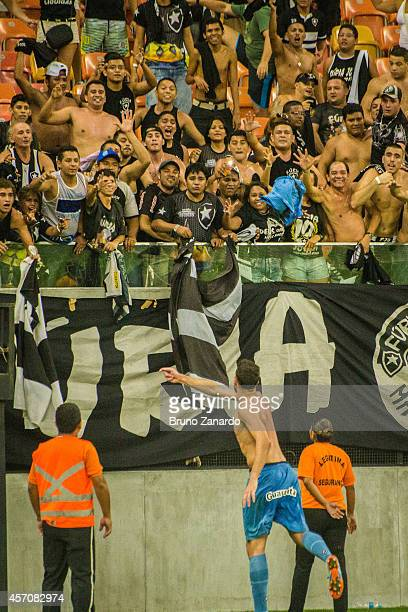 Helton Milk of Botafogo throw his uniform to the fans and celebrates his victory against Corinthians team during the Brasileirao Series A 2014 match...