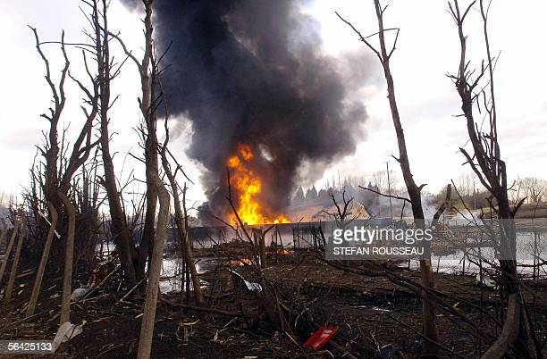 A blaze continues to burn at the Buncefield oil depot in Hemel Hempstead on the outskirts of London 13 December 2005 The blaze began following a...