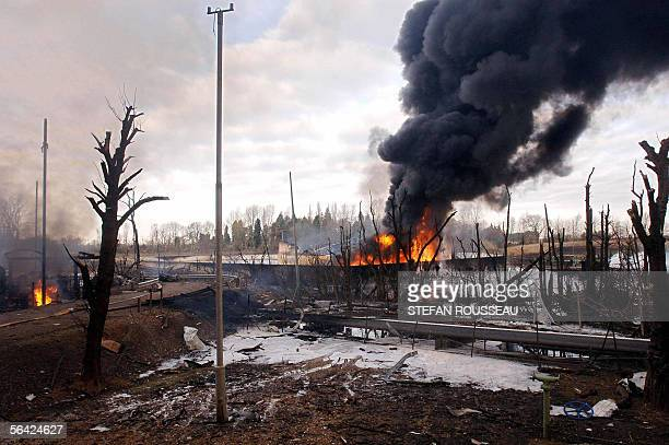 A fire continues to burn at the centre of an explosion at the Buncefield oil depot in Hemel Hempstead on the outskirts of London 13 December 2005...