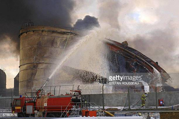 Firefighters at the Buncefield oil depot in Hemel Hempstead on the outskirts of London continue to fight a blaze 13 December 2005 Fuel overflowing...