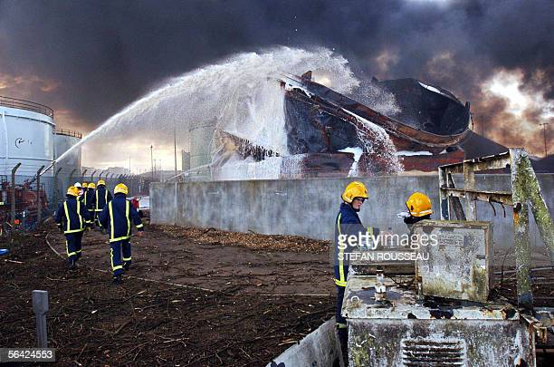 Firefighters continue to fight a blaze at the Buncefield oil depot in Hemel Hempstead on the outskirts of London 13 December 2005 which has been...