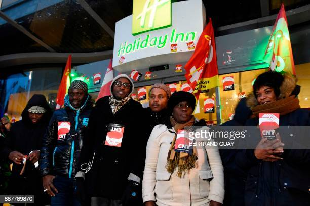 Hemera subcontractor cleaning workers demonstrate on December 7 in front of the Holiday Inn Porte de Clichy hotel in Clichy after a 50 days strike...