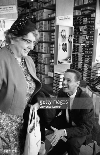 Hemodialysis patient and shoe salesman Harvey Gentry shares a laugh with a customer at work Washington 1962 Gentry was one of the first patients at...