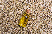 Hemp oil on seeds background. Top view