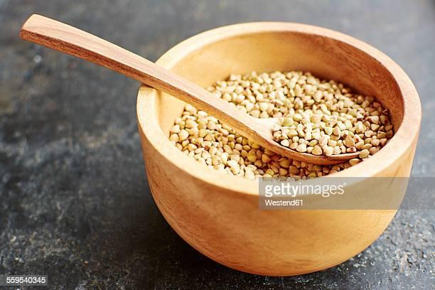 Hemp seeds in a wooden bowl.