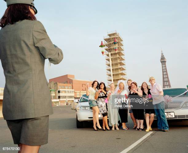 A hen party pose for a photograph taken by a female limousine driver hired for the occasion
