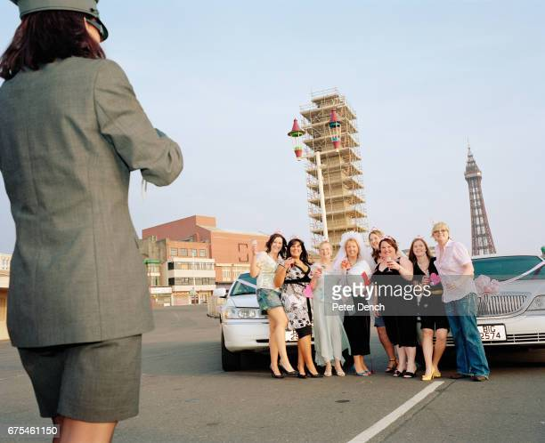 A hen party poses for a photograph taken by a female limousine driver hired for the occasion near Blackpools famous tower April 2007