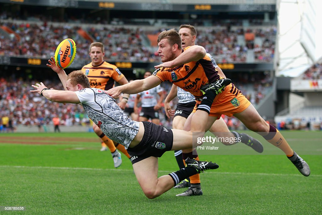 Henare Wells of the Warriors fumbles the ball over the tryline under pressure from Jai Arrow of the Broncos during the 2016 Auckland Nines match between the New Zealand Warriors and the Brisbane Broncos at Eden Park on February 7, 2016 in Auckland, New Zealand.