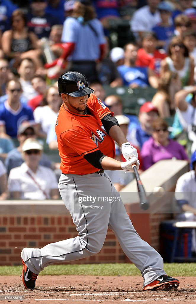 <a gi-track='captionPersonalityLinkClicked' href=/galleries/search?phrase=Henderson+Alvarez&family=editorial&specificpeople=7091625 ng-click='$event.stopPropagation()'>Henderson Alvarez</a> #37 of the Miami Marlins connects on a three-run home run scoring teammates Ed Lucas #59 and Jeff Mathis #6 during the second inning against the Chicago Cubs at Wrigley Field on September 2, 2013 in Chicago, Illinois.