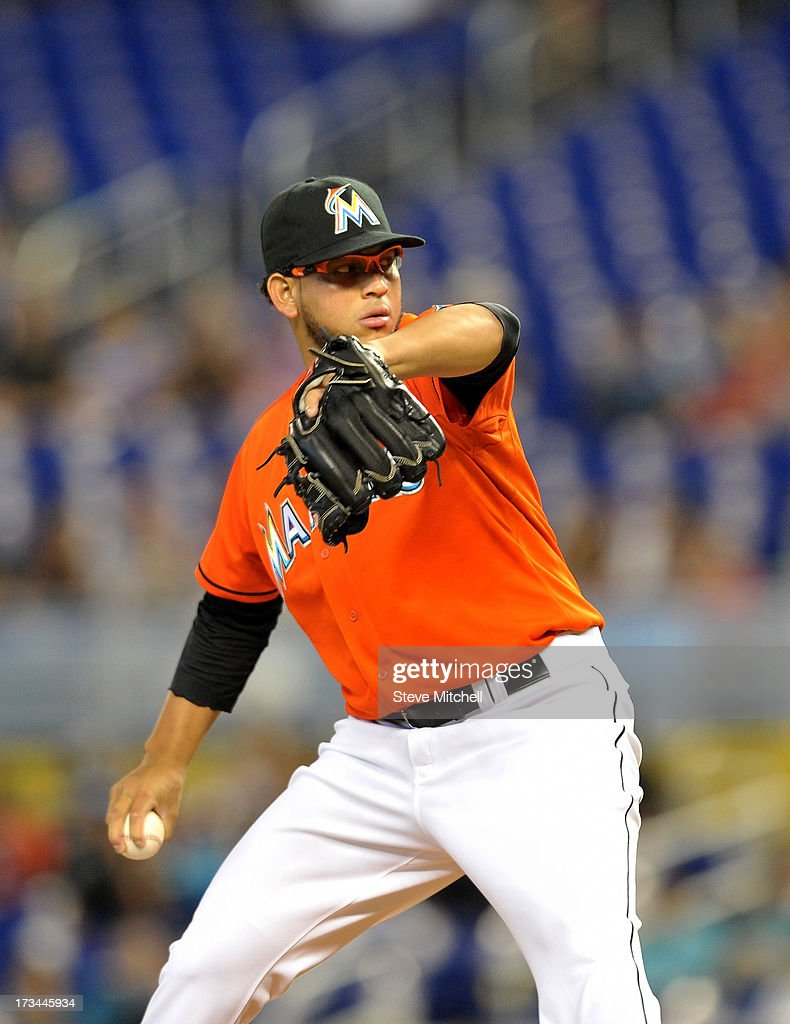 <a gi-track='captionPersonalityLinkClicked' href=/galleries/search?phrase=Henderson+Alvarez&family=editorial&specificpeople=7091625 ng-click='$event.stopPropagation()'>Henderson Alvarez</a> #37 of the Miami Marlins delivers a pitch during the first inning against the Washington Nationals at Marlins Park on July 14, 2013 in Miami, Florida.