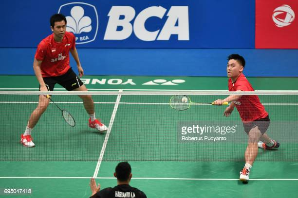 Hendra Setiawan of Indonesia and Boon Heong Tan of Malaysia compete against Kenas Adi Haryanto and Moh Reza Pahlevi Isfahani of Indonesia during...