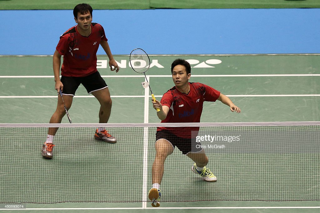 <a gi-track='captionPersonalityLinkClicked' href=/galleries/search?phrase=Hendra+Setiawan&family=editorial&specificpeople=2237241 ng-click='$event.stopPropagation()'>Hendra Setiawan</a> of Indonesia returns a shot as team mate Mohammad Ahsan watches on during their Men's Doubles semi final match against Hirokatsu Hashimoto and Noriyasu Hirata of Japan on day five of the Badminton YONEX Open on June 14, 2014 in Tokyo, Japan.
