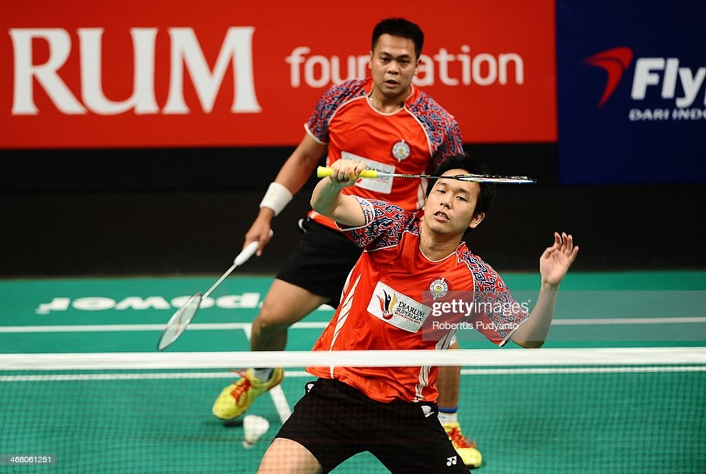 <a gi-track='captionPersonalityLinkClicked' href=/galleries/search?phrase=Hendra+Setiawan&family=editorial&specificpeople=2237241 ng-click='$event.stopPropagation()'>Hendra Setiawan</a>/<a gi-track='captionPersonalityLinkClicked' href=/galleries/search?phrase=Markis+Kido&family=editorial&specificpeople=4064412 ng-click='$event.stopPropagation()'>Markis Kido</a> of Jaya Raya Jakarta returns a shot against Ryan Agung Saputra/Wahyu Nayaka of Musica Flypower Champion during Djarum Super Liga Badminton 2014 Men's Final on February 9, 2014 in Surabaya, Indonesia. Musica Flypower Champion wins Djarum Superliga Badminton 2014 after beating Jaya Raya Jakarta 3-2.