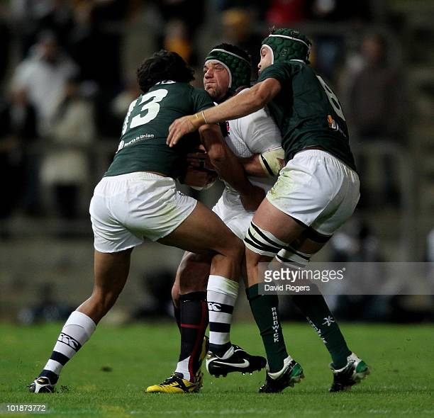 Hendre Fourie of England is tackled by Will Chambers and Stephen Hoiles during the match between the Australian Barbarians and England at the Members...