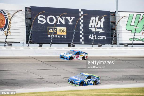 Hendrick Motorsports Lowe's Chevy driver Jimmie Johnson and JTG Daugherty Racing Kroger ClickList Chevy driver AJ Allmendinger during the Monster...