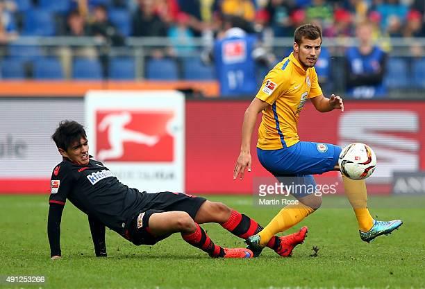 Hendrick Zuck of Braunschweig challenges for the ball with Eroll Zejnullahu of Union Berlin during the Second Bundesliga match between Eintracht...