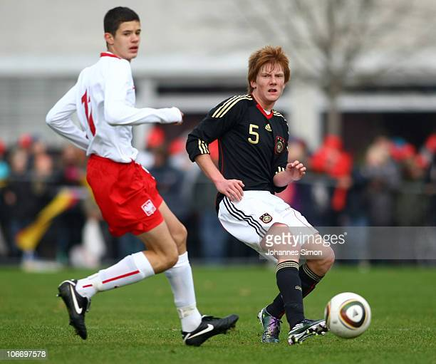 Hendrik Brauer of Germany and Oskar Zawada of Poland fight ball during the international friendly match U15 Germany v U15 Poland at Birkenallee...
