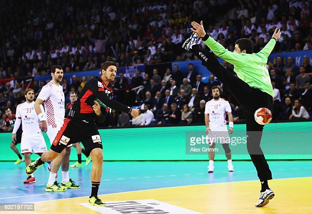 Hendrik Pekeler of Germany throws a goal during the 25th IHF Men's World Championship 2017 match between Germany and Croatia at Kindarena on January...