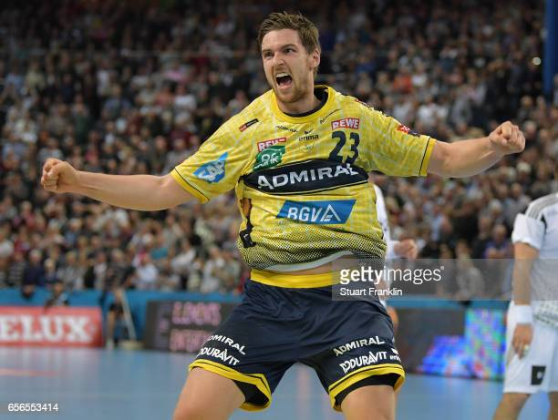 Hendrik Pekeler of Rhein Neckar celebrates scoring the winning goal during the first leg round of 16 EHF Champions League match between THW Kiel and...