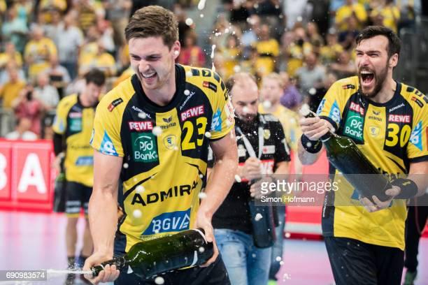 Hendrik Pekeler of RheinNeckar Loewen and Gedeon Guardiola Villaplana celebrate after the DKB HBL match between RheinNeckar Loewen and THW Kiel at...