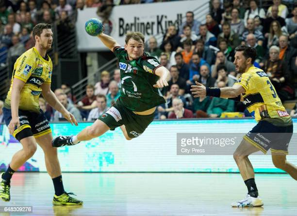 Hendrik Pekeler of the RheinNeckar Loewen Paul Drux of Fuechse Berlin and Alexander Petersson of the RheinNeckar Loewen during the game between the...