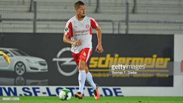 Hendrik Starostzik of Halle runs with the ball during the 3 Liga match between Sportfreunde Lotte and Hallescher FC at Frimo Stadium on September 29...