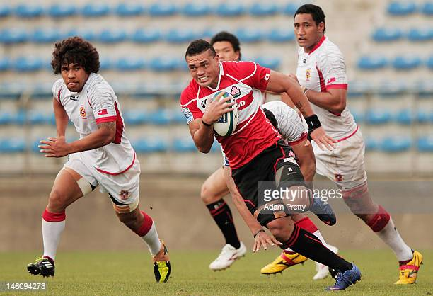 Hendrik Tui of Japan makes a break during the IRB Pacific Nations Cup match between Japan and Tonga at Prince Chichibu Memorial Stadium on June 10...