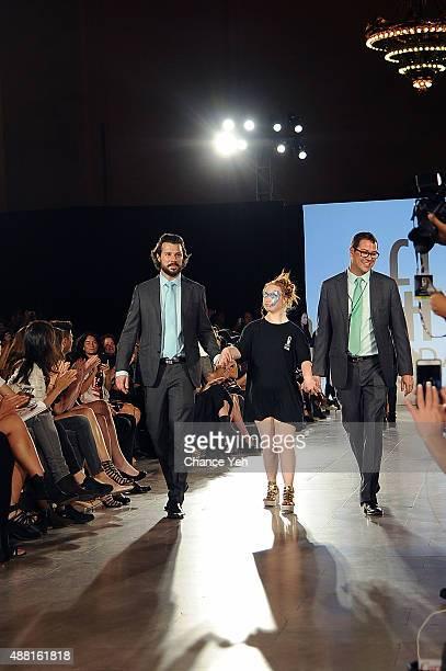 Hendrik Vermeulen model Madeline Stuart and JeanDaniel MeyerVermeulen walk the runway finale at Hendrik Vermeulen show during Spring 2016 during New...