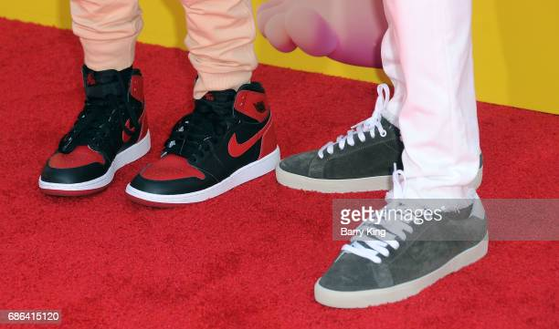 Hendrix Hart and actor Kevin Hart shoe detail attend premiere of DreamWorks Animation and 20th Century Fox's 'Captain Underpants' at Regency Village...
