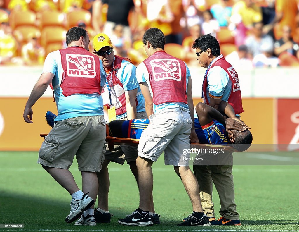 Hendry Thomas #12 of the Colorado Rapids is carried off the field after being injured in the second half against the Houston Dynamo at BBVA Compass Stadium on April 28, 2013 in Houston, Texas.