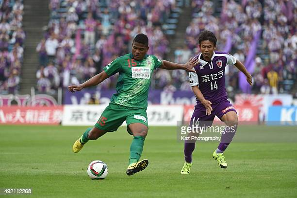 Henik of FC Gifu passes the ball while Koji Yamase of Kyoto Sanga watches during the JLeague 2nd division match between Kyoto Sanga and FC Gifu at...
