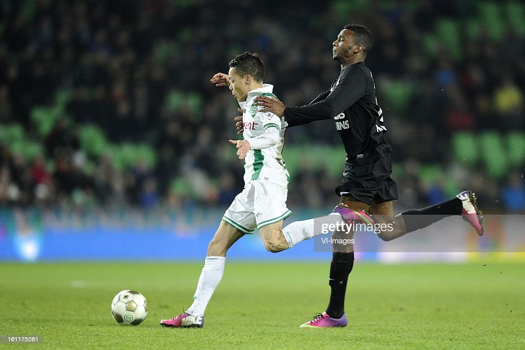Henk Bos of FC Groningen, Cuco Martina of RKC Waalwijk, during the Dutch Eredivisie match between FC Groningen and RKC Waalwijk at the Euroborg on february 9, 2013 in Groningen, The Netherlands