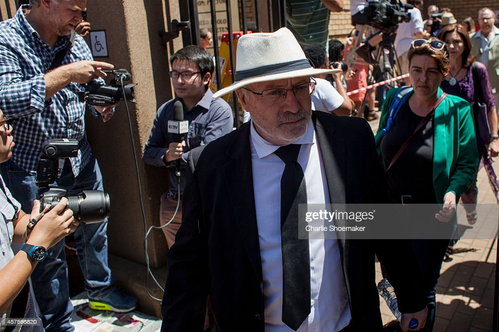 Henke Pistorius father of Oscar leaves the North Gauteng High Court on October 21 2014 in Pretoria South Africa Pistorius has been sentenced to the...