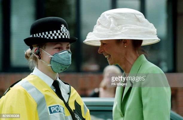 A Henley lady asks directions from a policewoman wearing a mask to protect her from the fumes of the cars on her way to the Royal Regatta today...