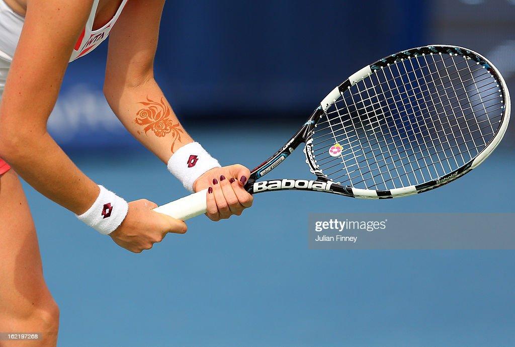 Henna body paint is seen on the arm of Agnieszka Radwanska of Poland in her match against Yulia Putintseva of Kazakhstan during day three of the WTA Dubai Duty Free Tennis Championship on February 20, 2013 in Dubai, United Arab Emirates.