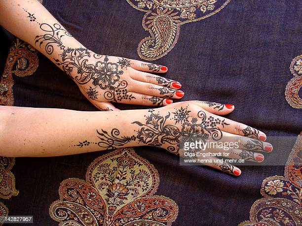 Henna hands with red nail polish