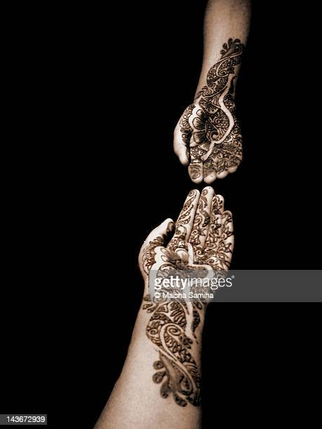 Henna mehndi on human hands