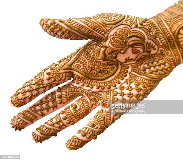 Henna on woman's hand against white background
