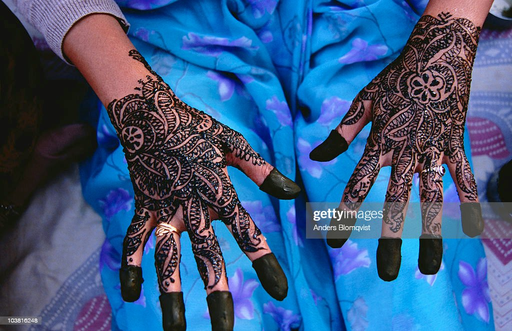 Henna patterns on a womans hands. : Stock Photo