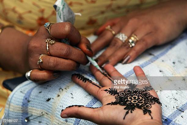 Henna tattoo is painted onto a childs hand during the Diwali Festival Of Lights at Britomart East on October 14 2006 in Auckland New Zealand Diwali...