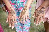 wedding celebration with henna tattoos