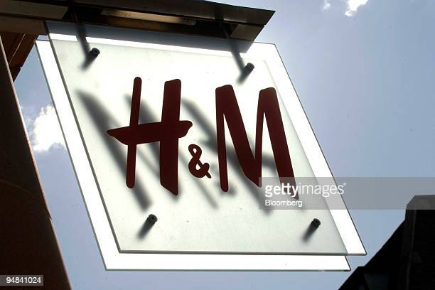 Hennes Mauritz AB company logo hangs outside a store in Cambridge UK on Monday Sept 29 2008 Hennes Mauritz AB Europe's secondbiggest clothes retailer...