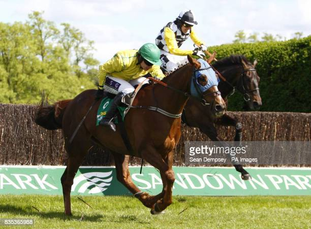 Hennessy and jockey Tony McCoy on their way to winning the Bet365 Gold Cup Handicap Chase during the bet365 Gold Cup Meeting at Sandown Park...